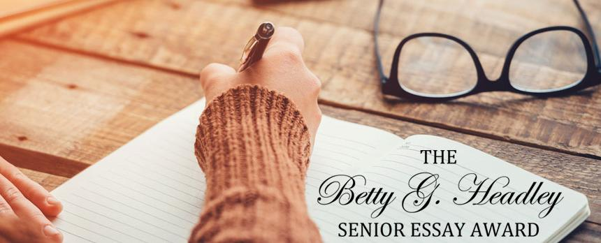 Image of a girl writing on a book saying THE BETTY G HEADLY SENIOR ESSAY AWARD