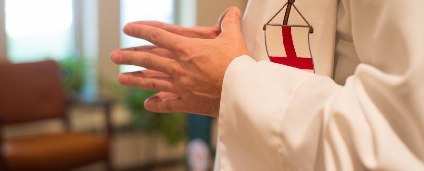 Image of a Priest praying