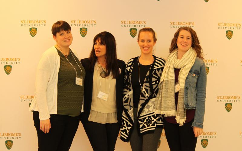 Picture of Professor Toni Serafini with SMF students